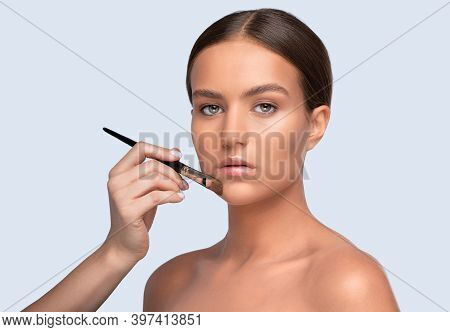 Portrait Of A Beautiful Charming Brunette Teenage Girl With Beautiful Fresh Makeup And Healthy Clean