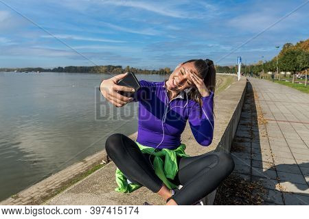 Young Sweaty Active Fitness Athlete Woman Taking A Break After Outdoor Training And Taking A Selfie