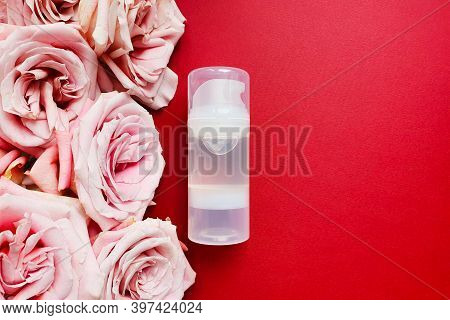 Transparent Bottle Of Intimate Lubricant Gel And Pink Roses On Red Background. Lifestyle, Flatlay, M