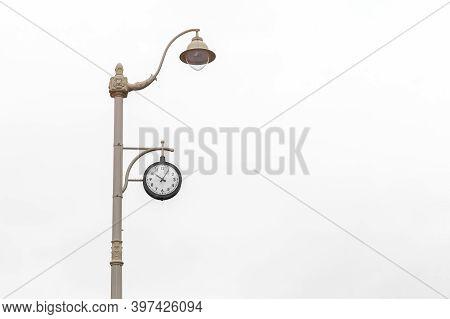 Modern Clock On A Beautiful Lamppost On A Light Background.