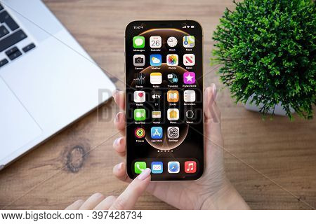 Alanya, Turkey - November 26, 2020: Woman Hand Holding Iphone 12 Pro Max Gold With Home Screen Ios 1