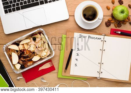 Notepad With Diet Program List And Lunch Box With Healthy Food Flat Lay At Wooden Desk On Workplace,