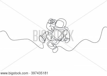 Single Continuous Line Drawing Of Spaceman Relaxing And Eating Sweet Glazed Donut In Nebula Galaxy.