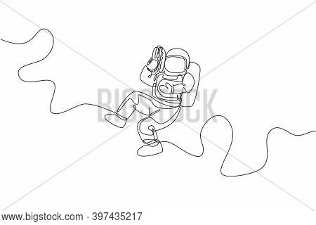Single Continuous Line Drawing Of Spaceman Holding And Eating Delicious Hot Dog In Nebula Galaxy. Fa