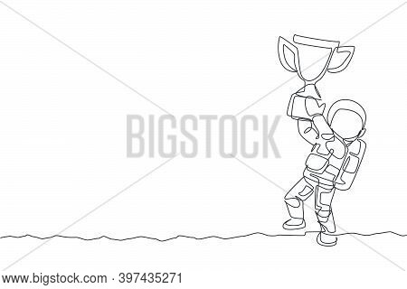 One Single Line Drawing Of Spaceman Astronaut Holding Winning Trophy In Cosmic Galaxy Vector Illustr