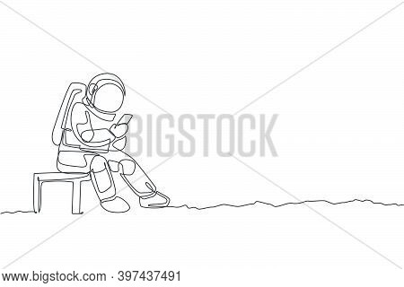 One Continuous Line Drawing Of Young Spaceman On Spacesuit Siting On Chair And Texting Using Handpho