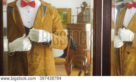 Aristocrat Puts On Jacket. Stock Footage. Rich Man Dresses For Celebration In 19th Century. Vintage