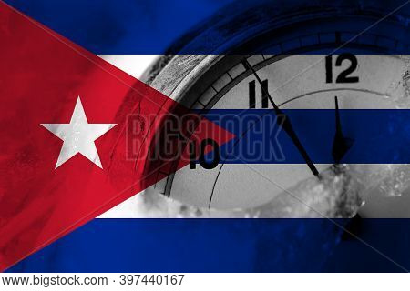 Cuba, Cuban Flag With Clock Close To Midnight In The Background. Happy New Year Concept