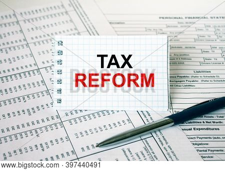 Notepad With Text Tax Form Lying On Financial Tables With A Pen