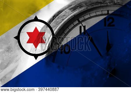 Netherlands, Dutch, Holland, Bonaire Flag With Clock Close To Midnight In The Background. Happy New