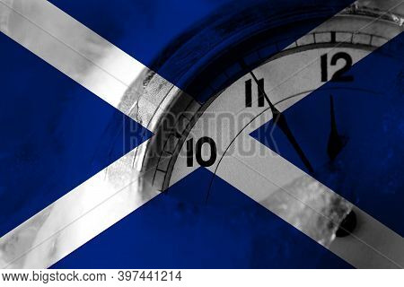 Scotland, Scottish, Scots Flag With Clock Close To Midnight In The Background. Happy New Year Concep