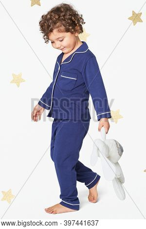 Girl in blue pajamas with a plush bunny