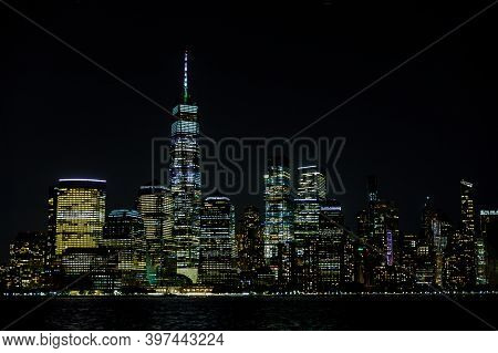 New York City Manhattan Ny Skyline Panorama At Night Over Hudson River With Reflections Viewed From