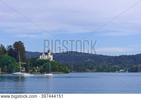 Boat On The Alpine Lake Worthersee, Famous Tourist Attraction For Boating And Swimming In Carinthia
