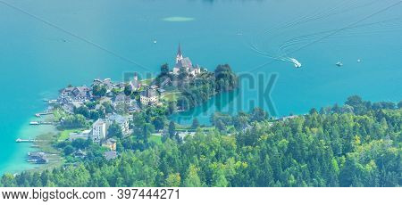 Aerial View With The Alpine Lake Worthersee From The Pyramidenkogel, The Highest Wooden Viewing Towe
