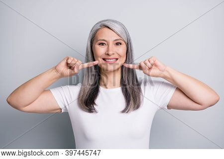 Photo Of Funny Cute Senior Lady Wear Casual Outfit Pointing Fingers Cheeks Isolated Grey Color Backg