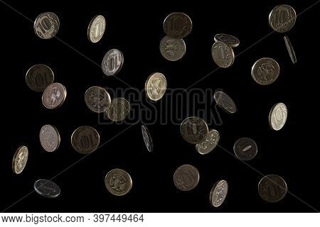 Russian Money. Falling Rubles, The Face Value Of 10 Rubles. Coins On A Black Background. Frozen Fall