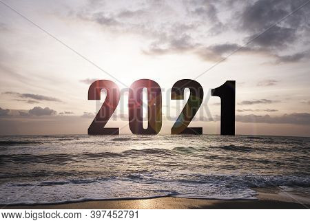 Silhouette Of Number 2021 On Sea With Sunrise And Morning Sky.welcome Merry Christmas And Happy New