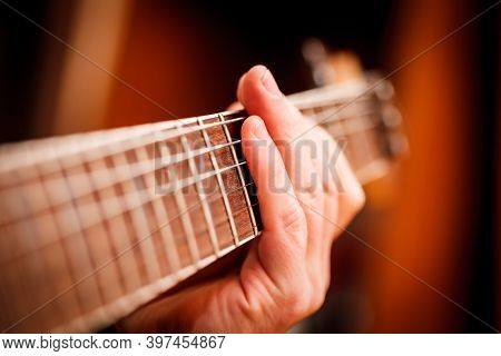 Man Playing Guitar On A Stage. Musical Concert. Close Up