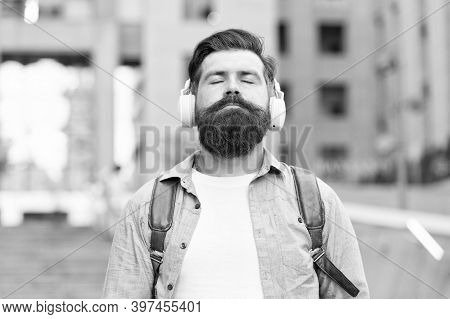 Audio Meditation. Bearded Man Listen To Music With Closed Eyes. Hipster Wear Audio Headphones Outdoo