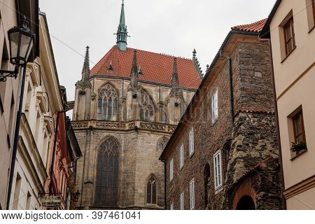 Medieval Stone St. Bartholomew´s Church, Gothic Cathedral At The End Of Narrow Street In Autumn Day,