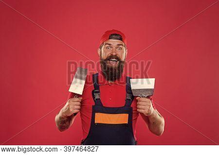 Plasterer Hipster Builder In Cap Red Background. Interior Designer. Professional Plasterer. Skillful
