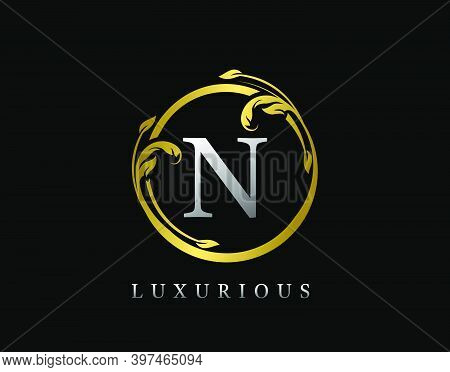 Luxury Circle Letter N Floral Design. Vintage Gold N Swirl Logo Icon.