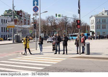 Moscow, Russia, 11 April, 2019: People Are Waiting For The Green Traffic Signal At The Pedestrian Cr