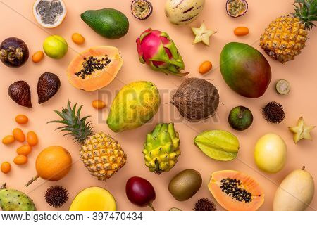 Fresh Fruits Background. Juicy Fruits. Mixed Tropicak Fruits On Beige Background. Advertisement Conc