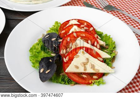 Salad With Fresh Tomatoes And Brined Cheese, Sunflower Seeds On Top