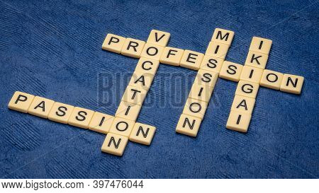 ikigai, passion, mission, profession and vocation crossword in letter tiles on handmade paper, Japanese lifestyle concept  - a reason for being as a balance between love, skills, needs and money