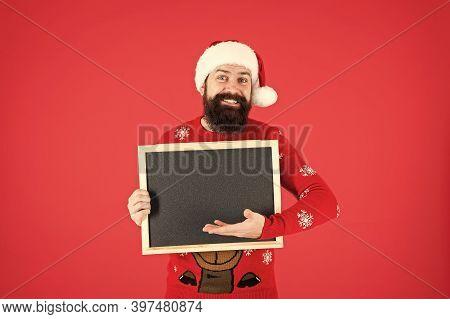 Information From Santa. Bearded Man Hold Blank Blackboard. Santa Point At Information Board. Informa