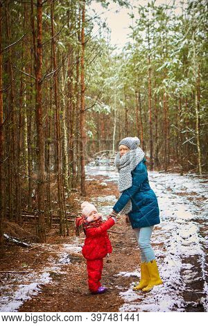 Young Mother Plays With Her Baby On A Winter Day