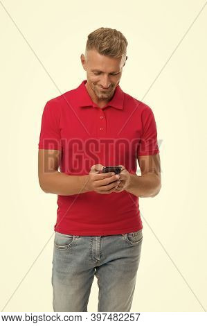 Texting Sms. Happy Man Send Sms Via Smartphone Isolated On White. Sms Messaging. Short Message Servi