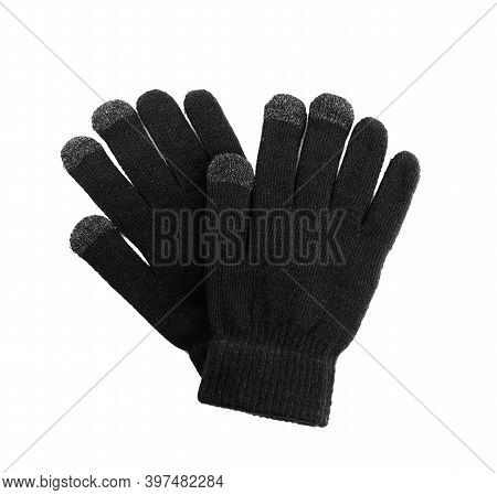 Black Woolen Gloves On White Background, Top View. Winter Clothes
