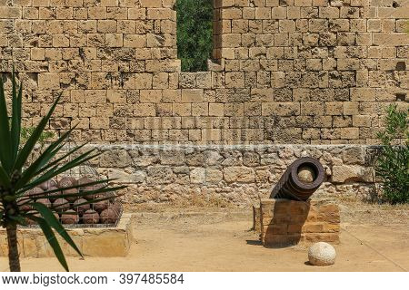 Cannon And Cannonballs At City Ruins In Famagusta In The Turkish Republic Of Northern Cyprus. Sunny