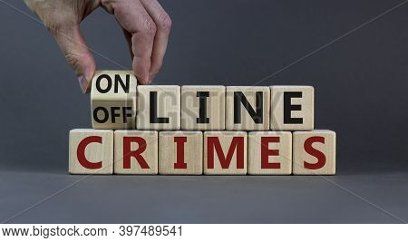 From Offline To Online Crimes. Male Hand Flips A Cube And Changes The Words 'offline Crimes' To 'onl