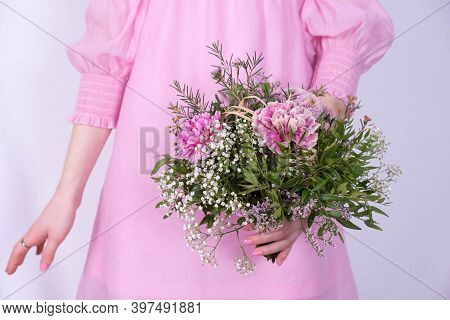 Bouquet Of Festive Flowers And A Girl In A Pink Dress On A White Background