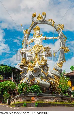 Traditional Statue Of The Deity Arjuna At The Entrance To Ubud. Monkey Forest