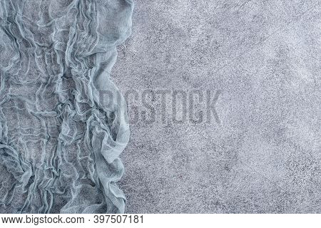 Gauze Tablecloth On Concrete Background. Top View, With Copy Space