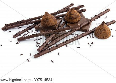 Sweet Delicious Chocolate Dessert Made From Truffle Candies, Pieces Of Broken Chocolate And Crispy S