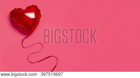 Love, Valentines Day Concept. Red Balloon In The Shape Of Heart On Pink Background Top View Flat Lay