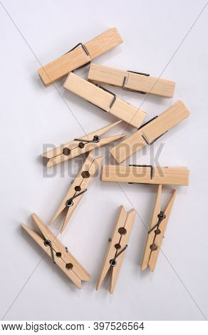 Wooden Clothes Pin. Closeup Pin Set On White Background