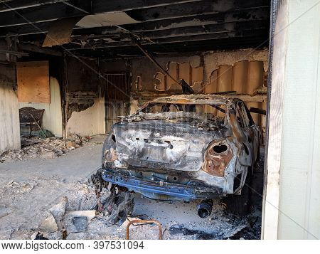 Honolulu, Hawaii - November 2, 2018: Inside Garage After A Fire With Burnt Walls, Ceiling And Car On