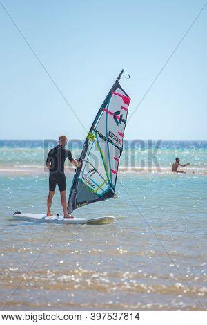 Sotavento, Fuerteventura, Spain: 2020 October 8: Man Learning Windsurfing At Playa De Sotavento, Fue