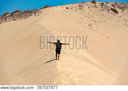 Sotovento, Fuerteventura, Spain: 2020 October 8: Young Man Walks Through The Dunes At Playa De Sotav