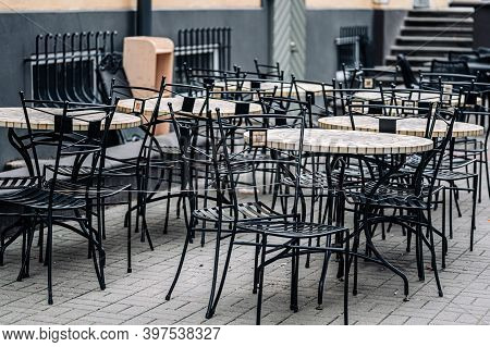 Empty Tables In The Outdoor Cafe. Deserted Street Cafe In Autumn.