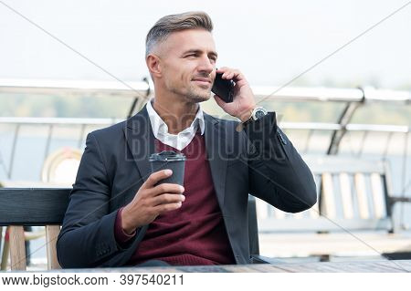 Smooth Out Your Day. Employee Talk On Phone Drinking Coffee Outdoors. Morning Habit. Morning Mood. B