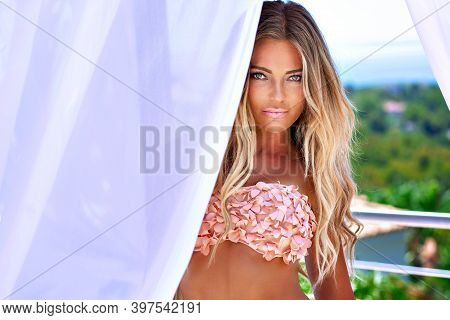 Beautiful Sexy Blonde Woman With Long Hair And Tanned Body Wearing Ping Swimsuit Sensual Posing Look