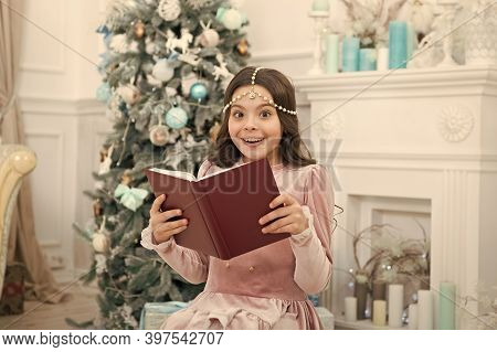 What Do You Fantasy For New Year. Happy Girl Hold Fantasy Book At Xmas Tree. Christmas Child Read Fa